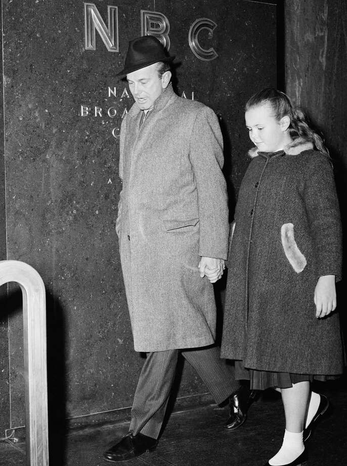 Television entertainer Jack Paar leaves the NBC Network building with his daughter Randy after holding a hurried news conference in New York on Feb. 13, 1960. Randy Paar died Saturday in New York City three days after a subway accident. (AP Photo/JR) Photo: JR, ASSOCIATED PRESS / AP1960