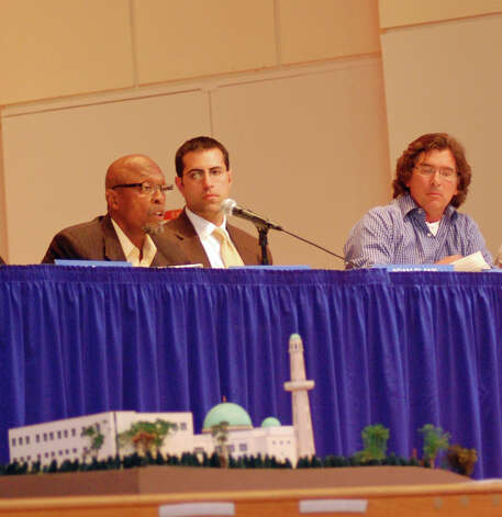 Norwalk Zoning Commissioner speaks in favor of a proposed mosque as commissioners Adam Blank and Michael Mushak look on Wednesday night at the Concert Hall at City Hall. The trio voted no to denying the mosque but were outnumbered. The commission voted 4-3 to deny the mosque. Photo: Nicole Rivard