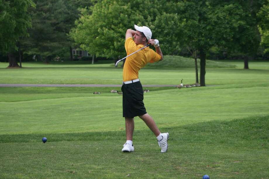 Weston's Max Catucci drives it during a regular season match. Catucci shot a 75 for the second-place Trojans at the Division III State Championships Monday and qualified as an individual for the New England Championships. Photo: Contributed Photo