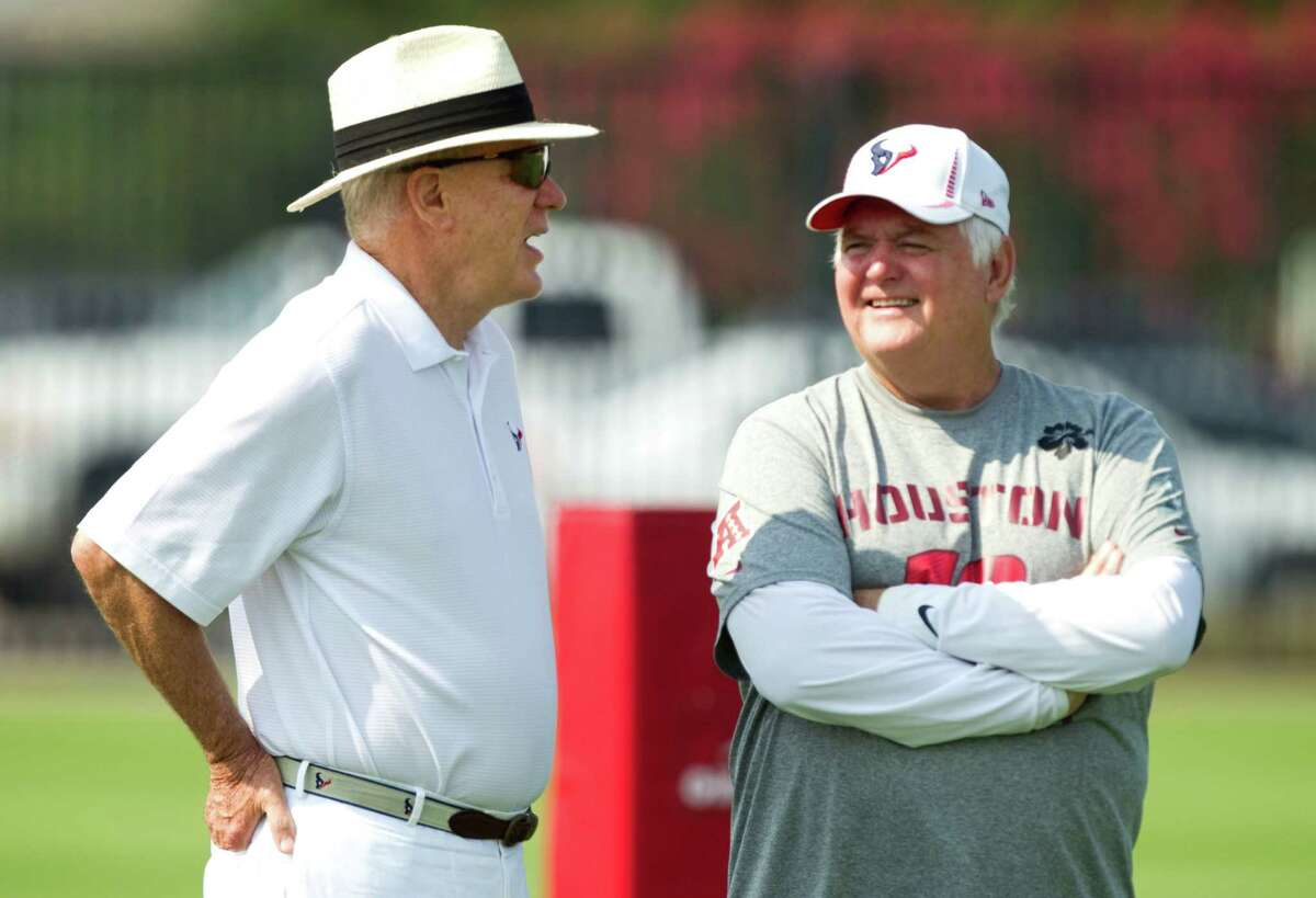 Houston Texans owner Bob McNair, left, talks to defensive coordinator Wade Phillips during Texans organized team activities at the Methodist Training Center Thursday, June 7, 2012, in Houston.