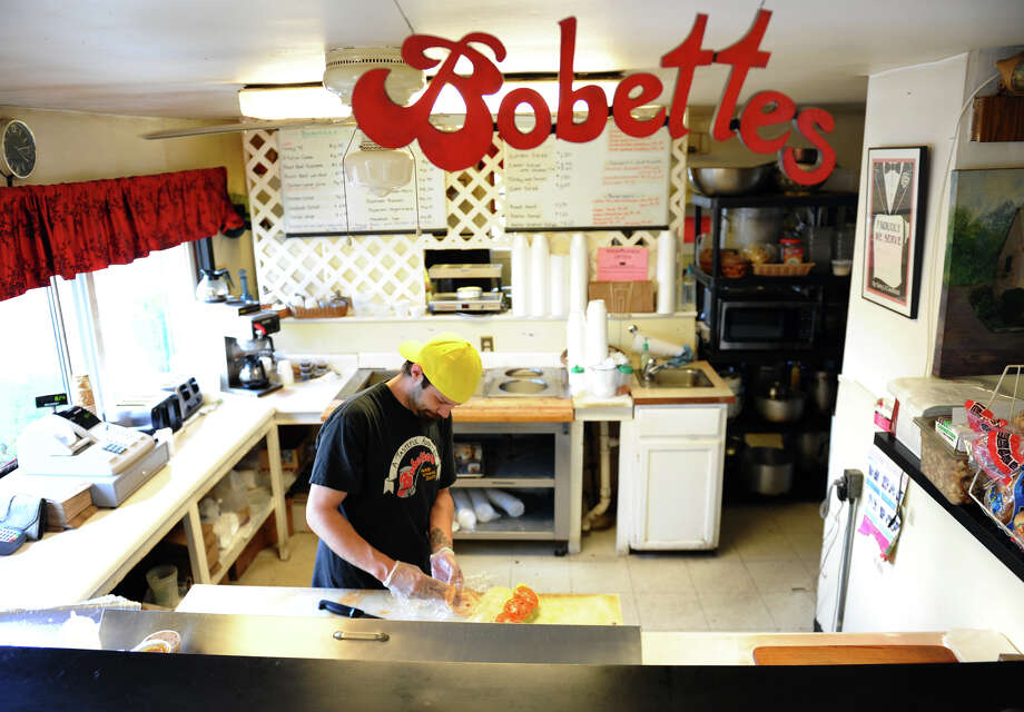 Bobette's employee Shane Rosselli prepares a lunch order at the shop in Milford, Conn. on Wednesday June 6, 2012. Photo: Christian Abraham / Connecticut Post