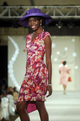 A model walks the runway at the Brentwood Scholarship Luncheon and Macy's Fashion Show at the Hilton Americas Hotel Sunday June 3,2012. (Dave Rossman/For the Chronicle) Photo: Dave Rossman / © 2012 Dave Rossman