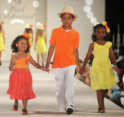 Models walk the runway at the Brentwood Scholarship Luncheon and Macy's Fashion Show at the Hilton Americas Hotel Sunday June 3,2012. (Dave Rossman/For the Chronicle) Photo: Dave Rossman / © 2012 Dave Rossman