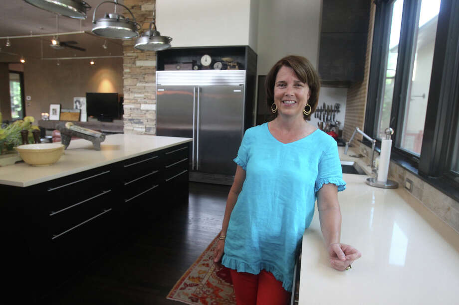 Cindi Dishron enjoys using her contemporary kitchen at he near North Side San Antonio home. Dishron collaborated with her husband Barney Dishron to complete the remodled kitchen. (Monday May 7, 2012) John Davenport/San Antonio Express-News Photo: SAN ANTONIO EXPRESS-NEWS