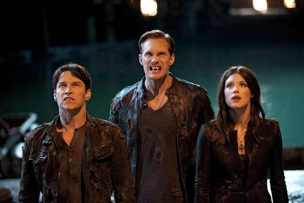 Stephen Moyer (from left), Alexander Skarsgard and Lucy Griffiths add some bite to the Season 5 premiere of 'True Blood.' Photo: HBO / LACEY TERRELL