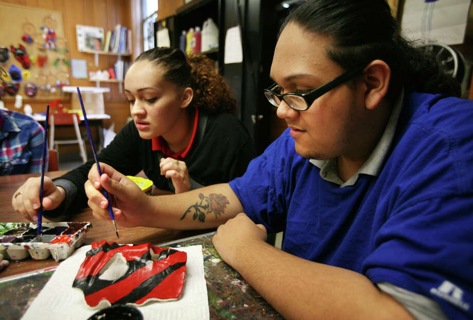 Freshman Thalia Muniz, 16, and junior Harold Delgado, 20, paint their ceramics projects during art class at the University School alternative education school in Bridgeport on Thursday, June 7, 2012. Photo: Brian A. Pounds / Connecticut Post