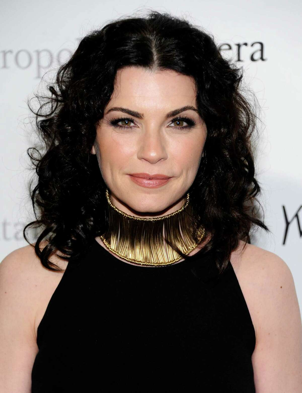 """FILE - In this March 24, 2011 file photo, actress Julianna Margulies attends the Metropolitan Opera's premiere of """"Le Comte Ory"""" sponsored by Yves Saint Laurent in New York. Julianna Margulies was nominated Thursday, Dec. 15, 2011 for a Golden Globe award for best actress in a television drama series for her role in """"The Good Wife."""" (AP Photo/Evan Agostin, filei)"""