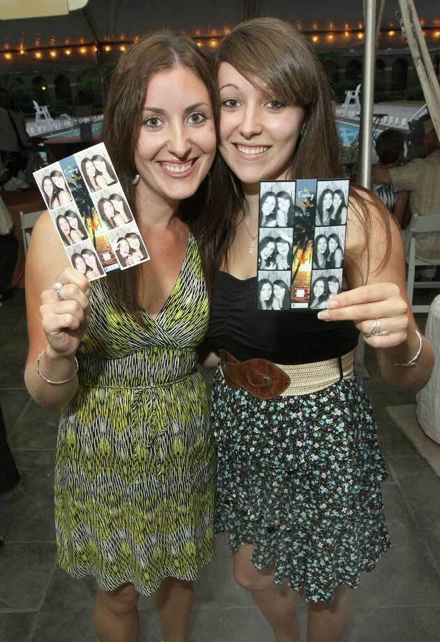 "Saratoga Springs, NY - June 1, 2012 - (Photo by Joe Putrock/Special to the Times Union) - Sarah(left) and Allison(right) Yurenda smile after viewing their photobooth portraits during the ""An Evening in Paradise"" themed Boogie off Broadway, presented by Saratoga Partners to benefit the campers of the Double H Ranch. Photo: Joe Putrock / Joe Putrock"