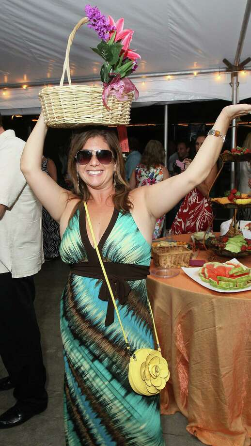 "Saratoga Springs, NY - June 1, 2012 - (Photo by Joe Putrock/Special to the Times Union) - Karen Ricci took an interesting approach, selling raffle tickets out of a basket on the top of her head, during the ""An Evening in Paradise"" themed Boogie off Broadway, presented by Saratoga Partners to benefit the campers of the Double H Ranch. Photo: Joe Putrock / Joe Putrock"