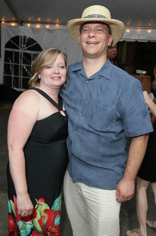 "Saratoga Springs, NY - June 1, 2012 - (Photo by Joe Putrock/Special to the Times Union) - Saratoga Partners President Kerri Herlick(left) and her husband Blake Herlick(right) were celebrating their sixteenth wedding anniversary during the ""An Evening in Paradise"" themed Boogie off Broadway, presented by Saratoga Partners to benefit the campers of the Double H Ranch. Photo: Joe Putrock / Joe Putrock"