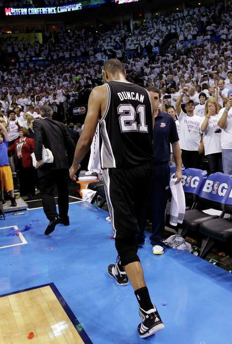 San Antonio Spurs center Tim Duncan (21) leaves the court after Game 6 in the NBA basketball Western Conference finals against the Oklahoma City Thunder, Wednesday, June 6, 2012, in Oklahoma City. The Thunder won 107-99. Photo: AP