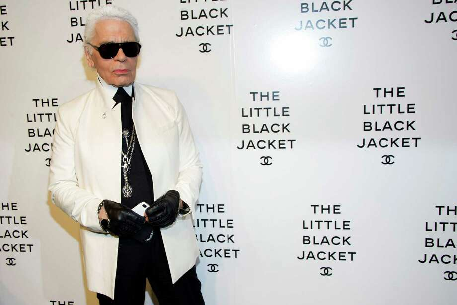 Karl Lagerfeld curated the exhibit revisiting Chanel's signature Little Black Jacket. Photo: Associated Press