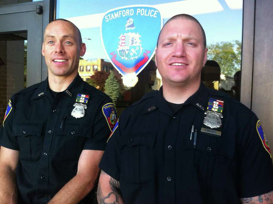 Stamford police officers Rhett Connelly, left, and Troy Judge, right, were named this year's Officers of the Year by the Stamford Police Association. The two officers, longtime partners working the midnight shift on the city's East Side, will be honored with the award June 14 during a dinner at The Waters Edge at Giovanni's in Darien. New York Yankees General Manager Brian Cashman is scheduled as the event's guest speaker. Photo: Jeff Morganteen