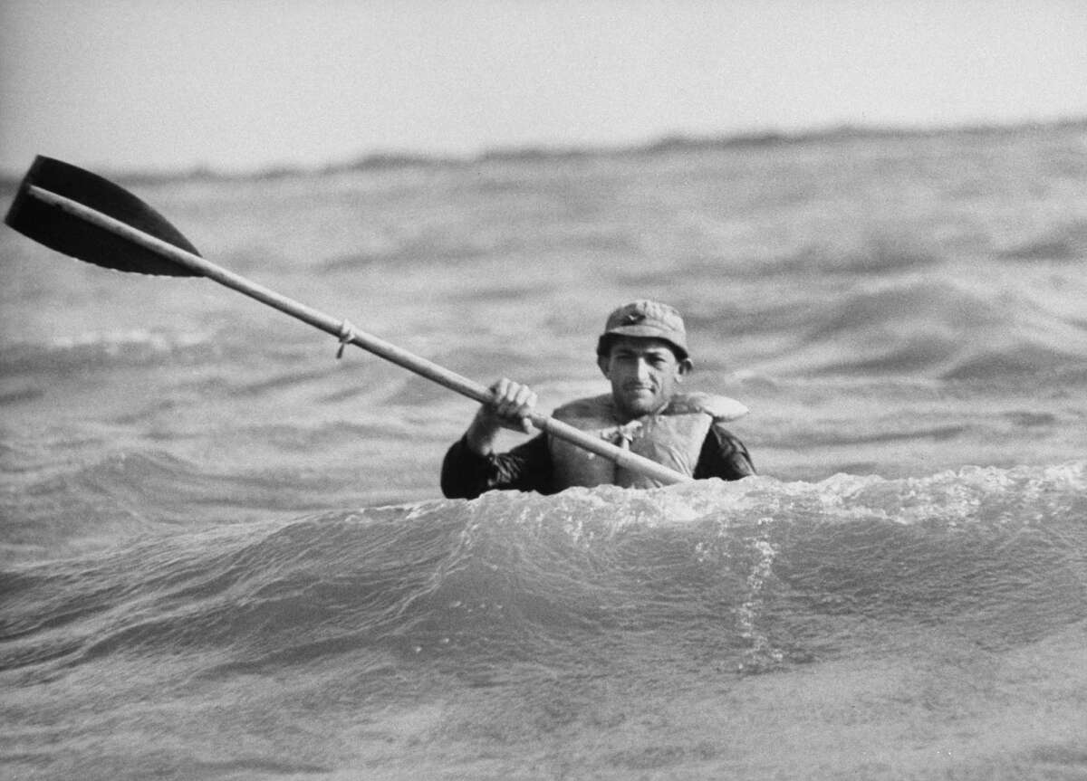 Contestant Roger Zimmerman in kayak during the rugged 12-day water safari obstacle race.