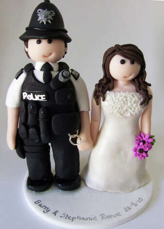 Policeman Wedding Cake Topper from Louise Hunter Photo: Flickr Creative Commons License
