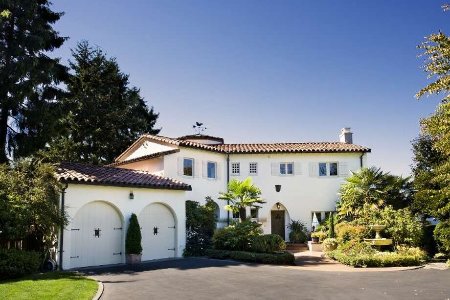 Want to experience the Mediterranean lifestyle on Puget Sound? Check out this house, built in 1931 at 1857 N.W. Roundhill Circle, in Blue Ridge. The 3,510-square-foot home has four bedrooms, 3.25 bathrooms, coved ceilings, wrought-iron railings, French doors, a sun room, wood-paneled bonus room, media room and wet bar on a landscaped, 0.4-acre lot. It's listed for $2.25 million. Photo: Courtesy Bob Bennion And Mary Snyder/Windermere Real Estate