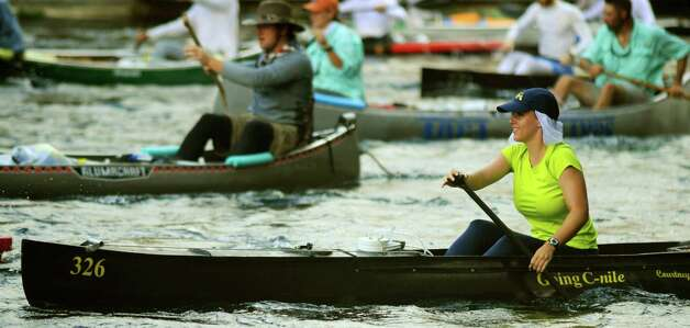 Courtney Weber, who will turn 21 during the Texas Water Safari run, paddles at the start at Aquarena Springs in San Marcos. BILLY CALZADA / gcalzada@express-news.net Photo: BILLY CALZADA, SAN ANTONIO EXPRESS-NEWS / gcalzada@express-news.net