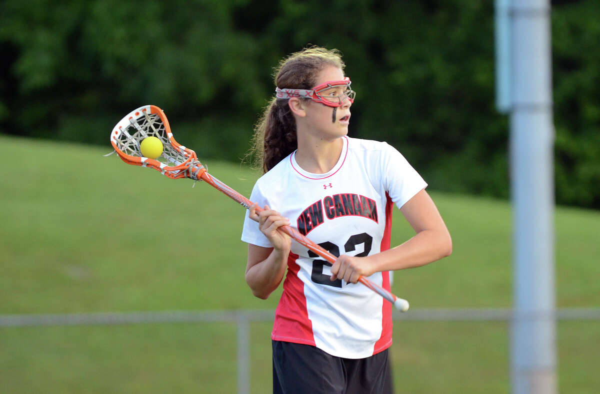 New Canaan's Olivia Hompe (22) controls the ball during the girls lacrosse Class M semifinals against New Fairfield at Bunnell High School in Stratford on Wednesday, June 6, 2012.