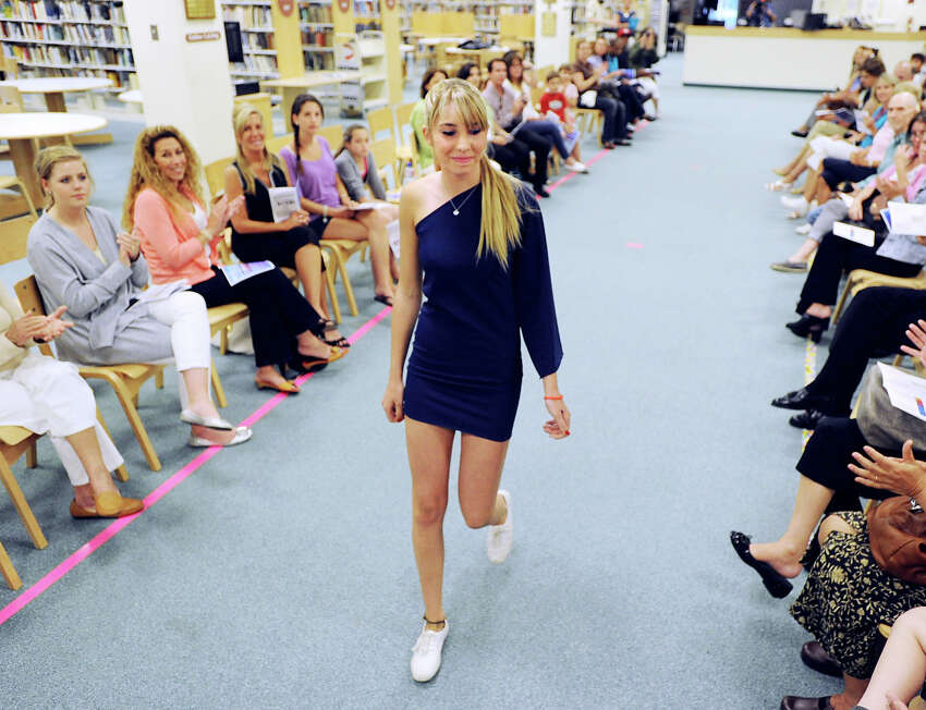 Greenwich High School student Dominique Conetta models a one-shoulder blue dress during the annual Greenwich High School Fashion Show put on by the school's fashion classes in the media center at the school, Thursday, June 7, 2012.