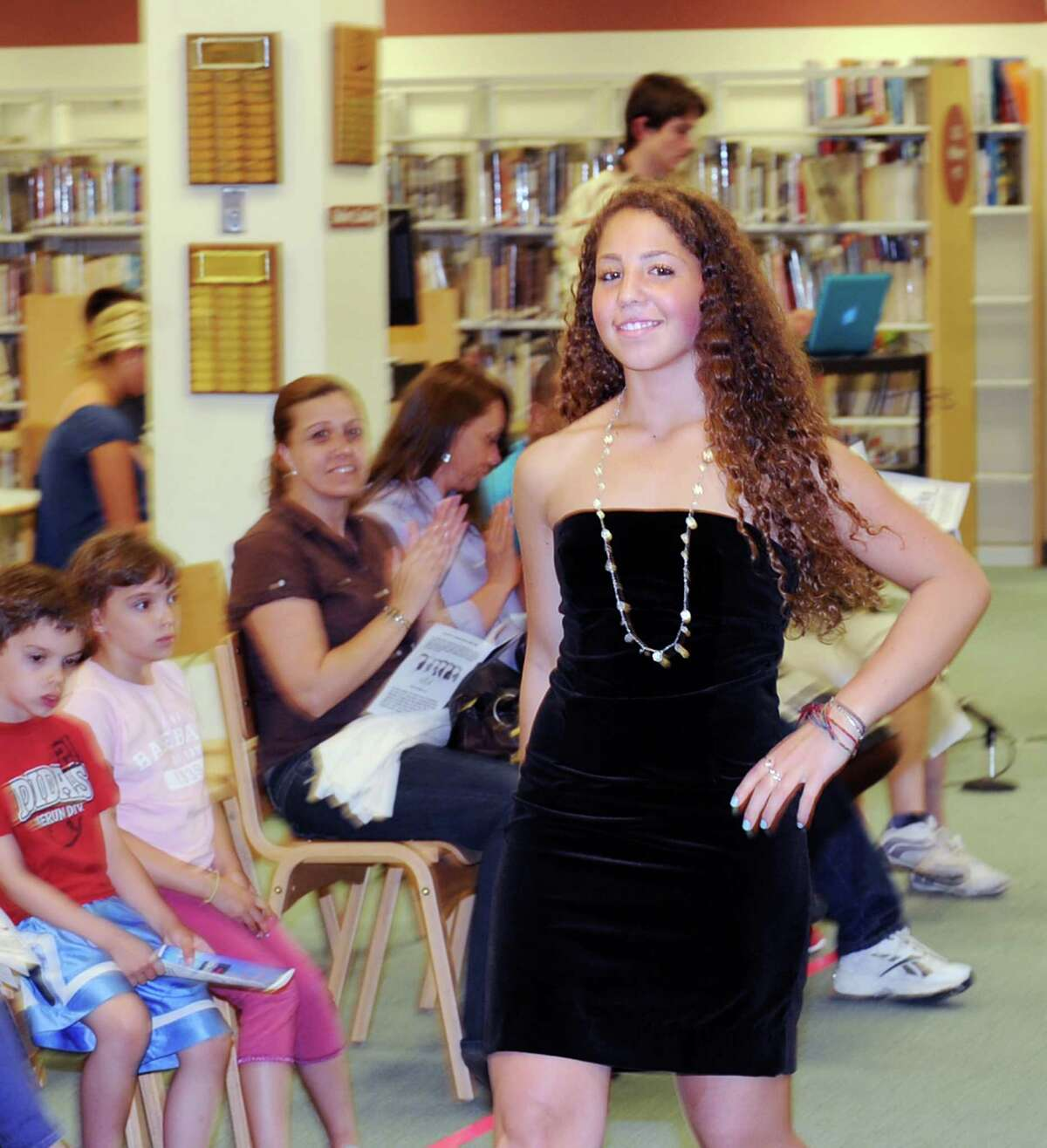 Greenwich High School freshman Michaela Ceci, 14, models a black dress during the annual Greenwich High School Fashion Show put on by the school's fashion classes in the media center at the school, Thursday, June 7, 2012.