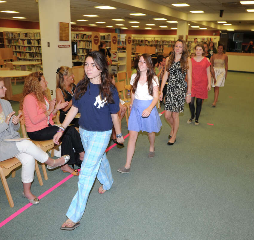 The annual Greenwich High School Fashion Show put on by the school's fashion classes in the media center at the school, Thursday, June 7, 2012.