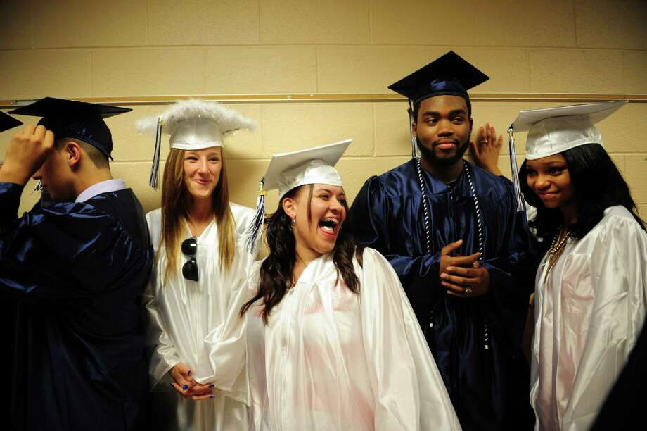 Graduates, from left, Sabina Gul, Vianca Guzman, Matt Hall and Lesley Hampton, line up before Ansonia High School's commencement ceremony Thursday, June 7, 2012 at the school in Ansonia, Conn. Photo: Autumn Driscoll / Connecticut Post