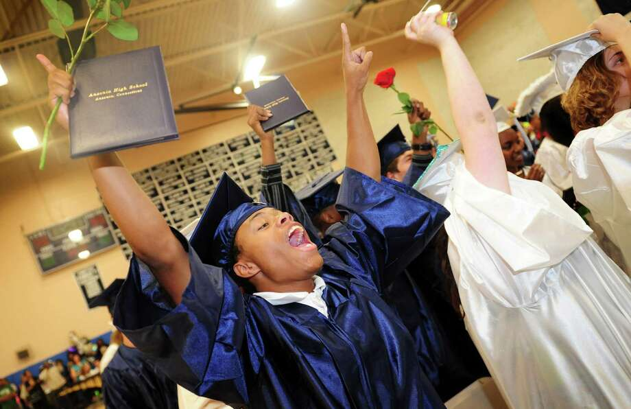 Graduate Percy Gladding celebrates during Ansonia High School's commencement exercises Thursday, June 7, 2012 at the school in Ansonia, Conn. Photo: Autumn Driscoll / Connecticut Post