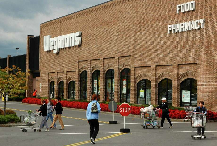 "18. Wegmans Food Markets -- first time on list. ""Wegman's had a significant number of mentions primarily as a place with passionate employees who are inspired by their work,"" the report said. Photo: MICHAEL P. FARRELL / ALBANY TIMES UNION"