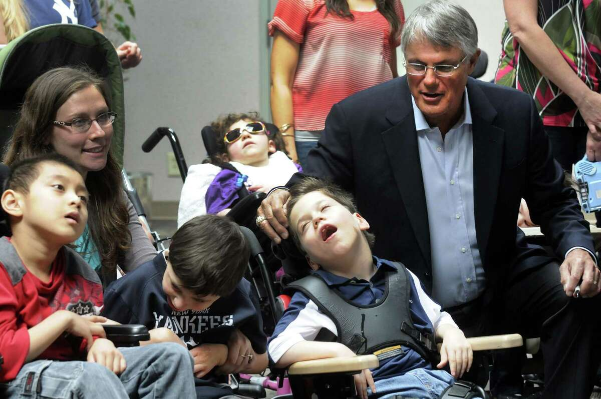 Former New York Yankees player, manager and general manager Lou Piniella, right talks with eight-year-old Aaron Raker during a visit to the Clover Patch Pre-School and Langan School at the Center for Disability Services in Albany, N.Y. Thursday June 7, 2012. (Michael P. Farrell/Times Union)