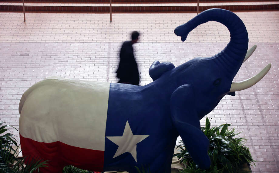 A person passes a Texas flag colored elephant while attending the 2012 Texas GOP Convention held at the Fort Worth Convention Center Thursday June 7, 2012 in Fort Worth, Texas. Photo: Edward A. Ornelas, San Antonio Express-News / © 2012 San Antonio Express-News