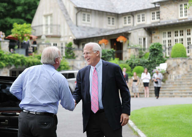 Karl Rove, left, a Republican political strategist, greets former Congressman Christopher Shays, before a press conference at the Greenwich home of Sidney Goodfriend, where Rove made a fundraising appearance Thursday, June 7, 2012, in support of Shays' Senate run. Photo: Bob Luckey / Greenwich Time
