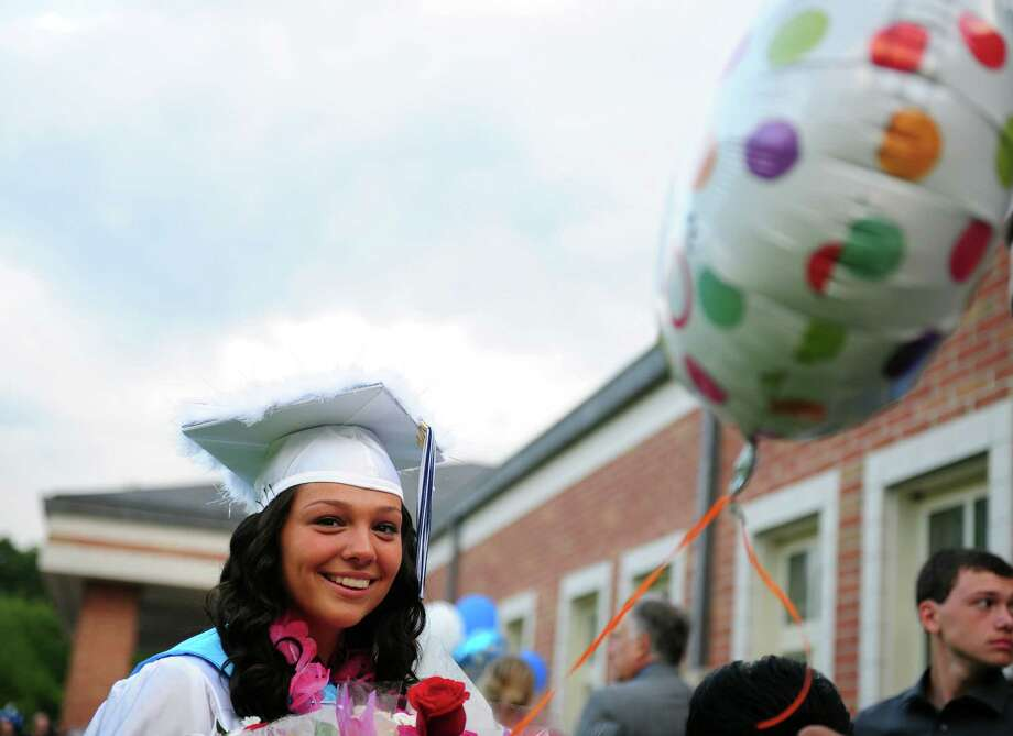 Graduate Caitlyn Rhodes holds a balloon from her family following Ansonia High School's commencement ceremony Thursday, June 7, 2012 at the school in Ansonia, Conn. Photo: Autumn Driscoll / Connecticut Post