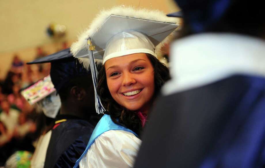 Graduate Caitlyn Rhodes looks back at friends during Ansonia High School's commencement ceremony Thursday, June 7, 2012 at the school in Ansonia, Conn. Photo: Autumn Driscoll / Connecticut Post