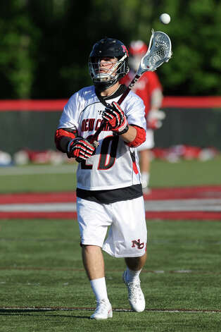 New Canaan's Matt Blasco controls the ball during Saturday's FCIAC boys lacrosse quarterfinal game against Greenwich at New Canaan High School on May 19, 2012. Photo: Lindsay Niegelberg / Stamford Advocate