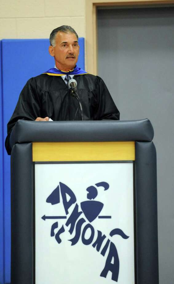 Principle Robert A. Lisi addresses graduates during Ansonia High School's commencement ceremony Thursday, June 7, 2012 at the school in Ansonia, Conn. Photo: Autumn Driscoll / Connecticut Post
