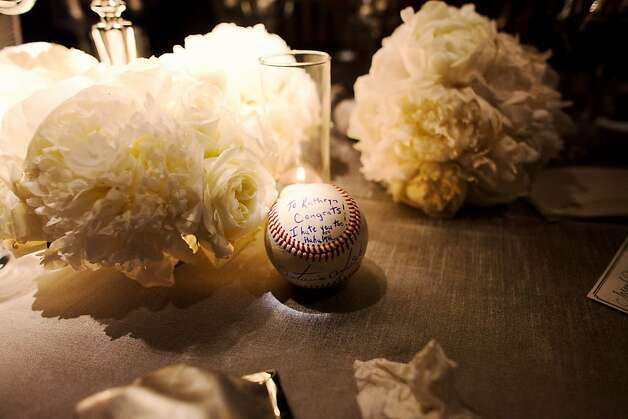 In honor of their first date, Joseph Della Cella presented his bride with a signed baseball by Antonio Alfonseca. Photo: Kate Harrison Photography