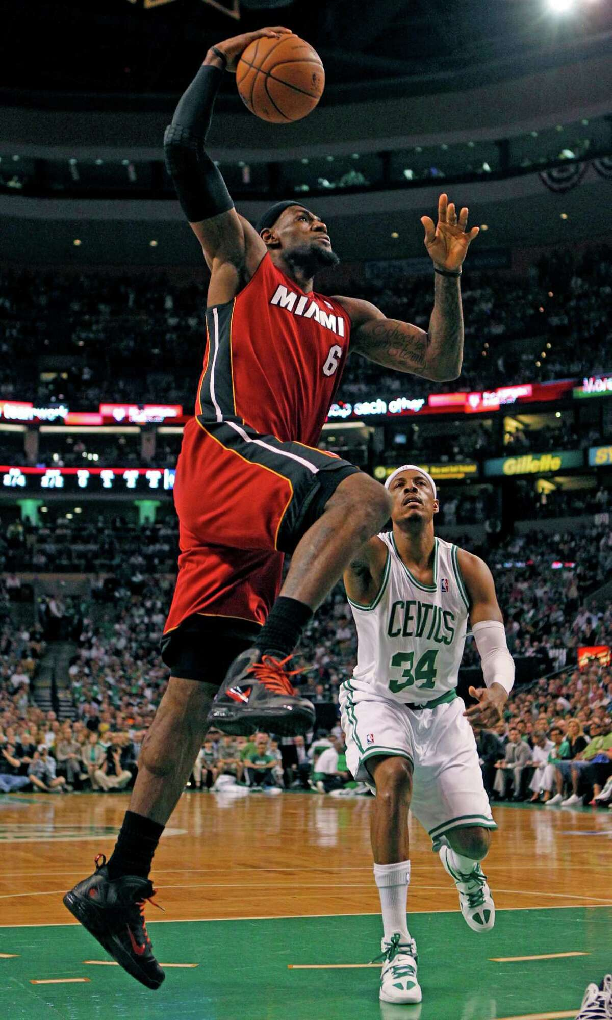 Miami Heat forward LeBron James (6) shoots over Boston Celtics forward Paul Pierce (34) during the first half in Game 6 of the NBA basketball Eastern Conference finals, Thursday, June 7, 2012, in Boston. (AP Photo/The Miami Herald, Charles Trainor Jr.) MAGS OUT