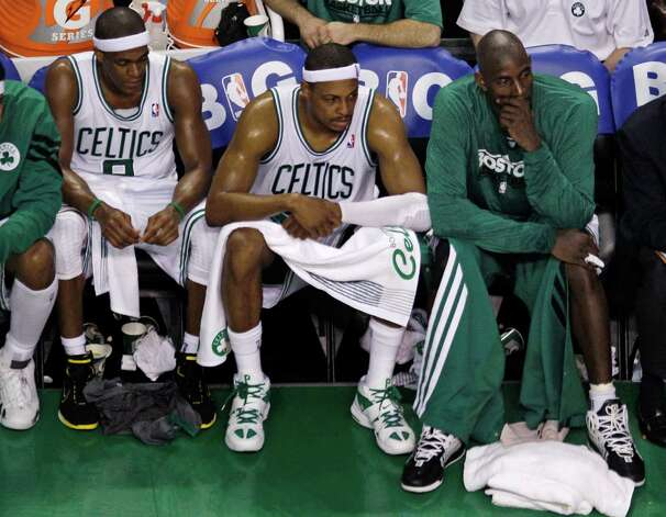From left, Boston Celtics' Rajon Rondo, Paul Pierce and Kevin Garnett sit on the bench during the fourth quarter in Game 6 of the NBA basketball Eastern Conference finals against the Miami Heat, Thursday, June 7, 2012, in Boston. (AP Photo/Charles Krupa) Photo: Charles Krupa