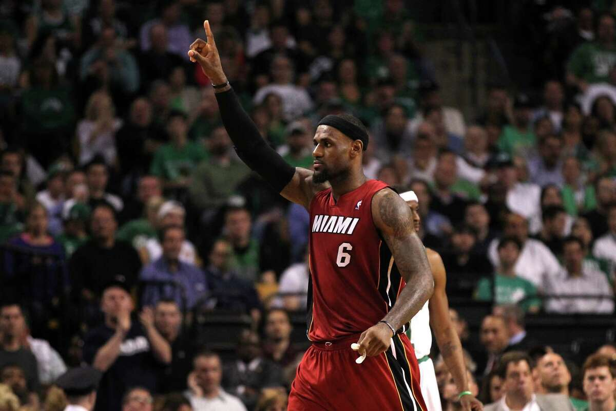 The Heat's LeBron James wore a look of determination as he stalked Boston's parquet floor in pursuit of a win to tie the series with the Celtics.