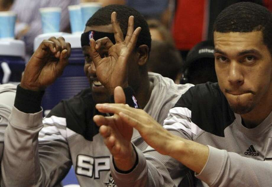 "Spurs 96, Clippers 86: On May 19, a 24-0 third-quarter blitz let Spurs charge back in Game 3 of the Western Conference semis. In the photo, the Spurs' Stephen Jackson (left) gestures toward an irate Clippers fan, ""three-zero."" (Kin Man Hui / San Antonio Express-News)"
