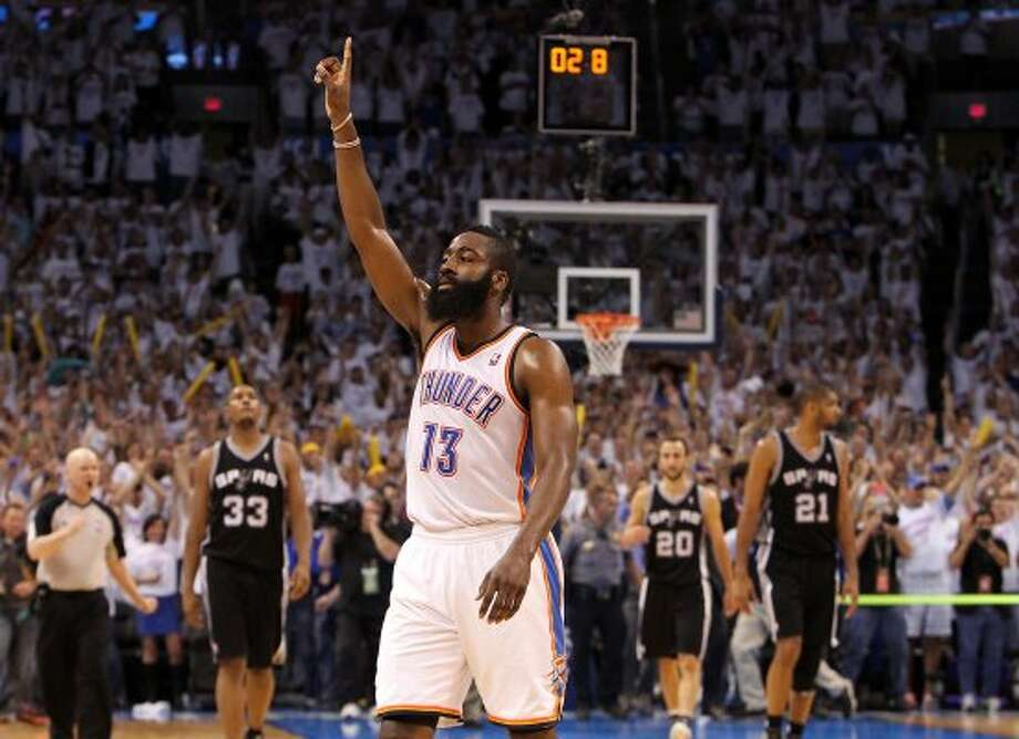 Thunder 107, Spurs 99: Spurs watched an early 18-point lead and 15-point halftime edge disappear as their season ended in Game 6 of the Western finals. In the photo, the Thunder's James Harden points near the end of the game. (Kin Man Hui / San Antonio Express-News)