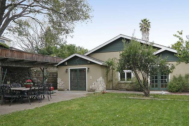 The fenced backyard of this spacious bungalow features a patio and a barn (not pictured) which can be used for housing livestock under current permitting. Photo: Terrace Associates, Blockshopper