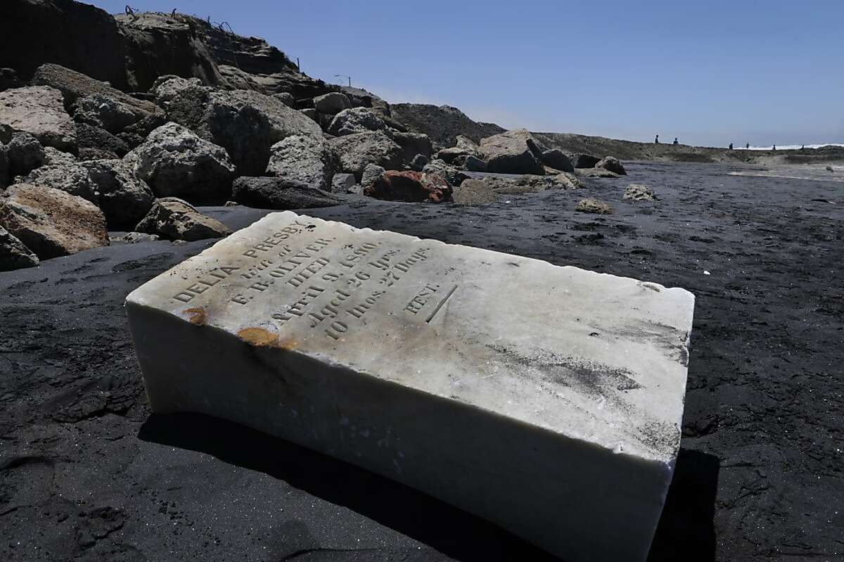 Near the intersection of Rivera Street and the Great Highway on Ocean Beach, tombstones were uncovered by wind and erosion on Thursday, June 7, 2012 in San Francisco, Calif.