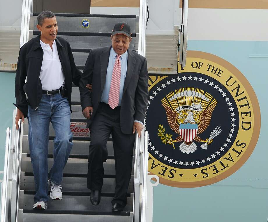 President Obama, left, and baseball icon Willie Mays exit Air Force One. Photo: Bill Boyce, AP