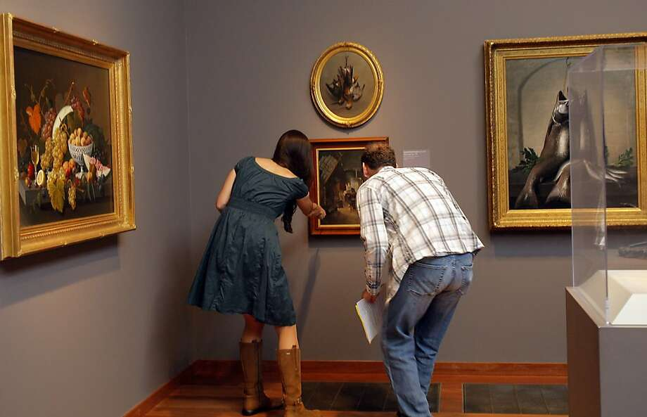 Ayesha Johnson, left, and Tom Yuzvinsky discuss a sign on a painting as a potential clue to solve a murder mystery on a scavenger hunt at De Young Museum in San Francisco, Calif. on May 5, 2012 Photo: Siana Hristova, The Chronicle