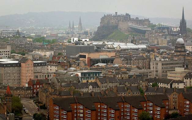 A general view of the city of Edinburgh, with Edinburgh Castle in the background as the number of confirmed cases of Legionnaires' disease following a deadly outbreak rises Thursday June 7, 2012. Health officials in Scotland say there are now 51 confirmed cases of Legionnaires' disease in an outbreak that has left one man dead. Scottish Health Secretary Nicola Sturgeon reported the latest number of cases in the Edinburgh-area outbreak to Scotland's Parliament on Thursday.    (AP Photo/David Cheskin/PA Wire) UNITED KINGDOM OUT NO SALES NO ARCHIVE Photo: David Cheskin, Associated Press