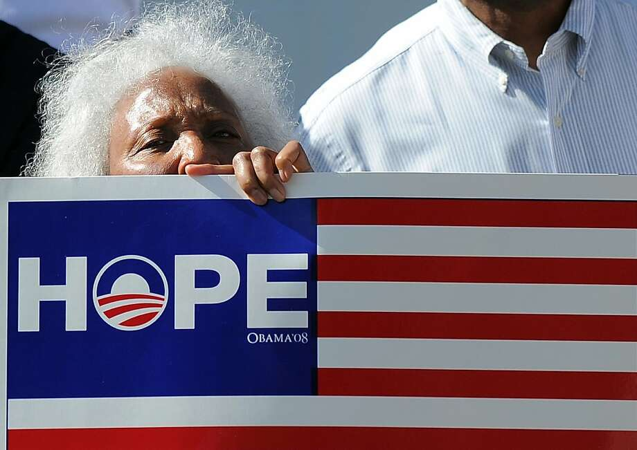 "TOPSHOTS - An elderly supporter of US President Barack Obama joins others to cheer near a house where Obama is holding a campaign event in Los Angeles, California, on June 7, 2012. Republican Presidential hopeful Mitt Romney has outraised Obama for the first time in the White House race, with the challenger raking in more than $76 million, campaign figures showed Thursday. Obama, who proved himself a fundraising juggernaut during his presidential run four years ago, raised ""more than $60 million"" in May along with the Democratic National Committee and local committees, the campaign said in a Twitter message. TOPSHOTS / AFP PHOTO / Jewel SamadJEWEL SAMAD/AFP/GettyImages Photo: Jewel Samad, AFP/Getty Images"