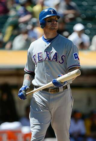 Texas' Josh Hamilton left Thursday's game complaining of a stomachache. Photo: Thearon W. Henderson, Getty Images