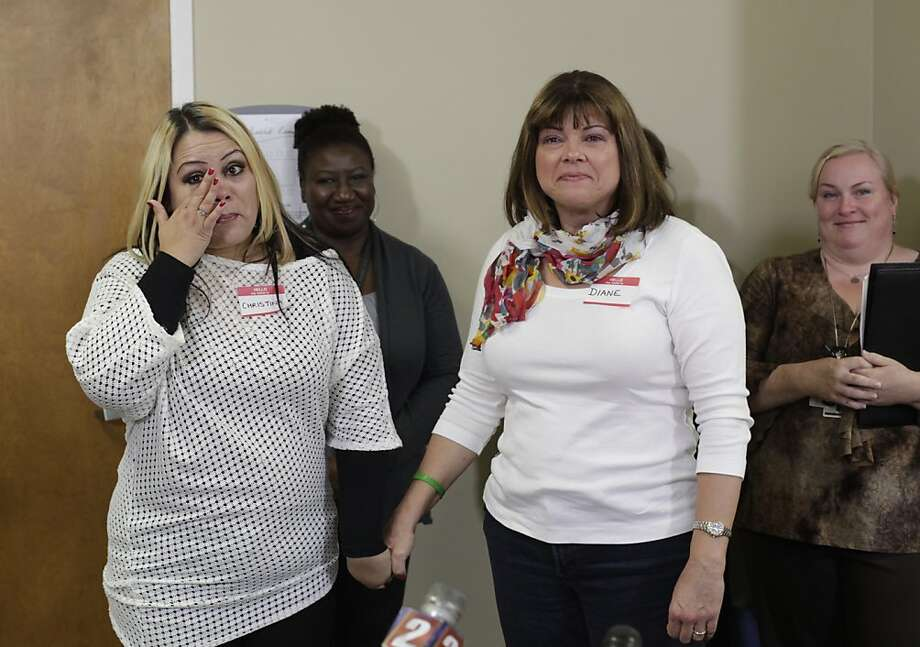 Christina Abeyta of Newman wipes tears from her face as she holds the hand of Diane Cooling of Gardnerville, Nevada after learning that Diane was the kidney donor for her transplant at California Pacific Medical Center on Thursday, June 7, 2012 in San Francisco, Calif. Four kidney donors and four kidney recipients came together for the first time after a 4-way kidney transplant swap that was performed in May where they learned for the first time who they were paired with for the transplants. Photo: Lea Suzuki, The Chronicle