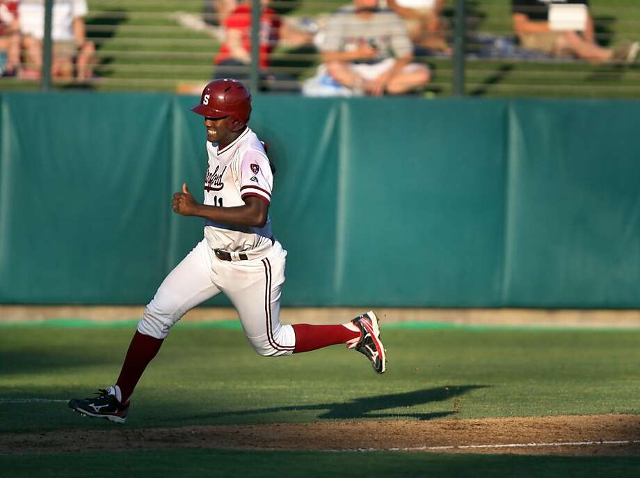 Brian Ragira slips past second base and makes his way to home plate on Friday during the NCAA regional game versus Fresno. Stanford met Fresno at Sunken Diamond on Friday for the NCAA Regional. Photo: Kevin Johnson, The Chronicle